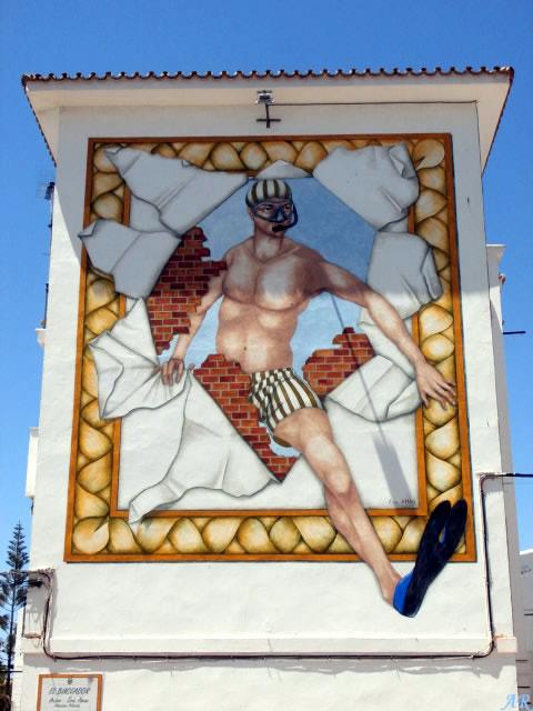 """Mural Artístico en Bda. Tres Banderas """"Ángel, el buceador"""" Artista: Eric Aman - Ruta de Murales Artísticos"""